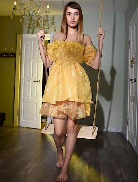 Blonde teen Zara strips out of her yellow dress