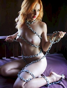 redhead Kristell chains herself up for you
