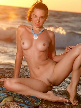 sexy babe Anita E shows off her gorgeous body on the beach