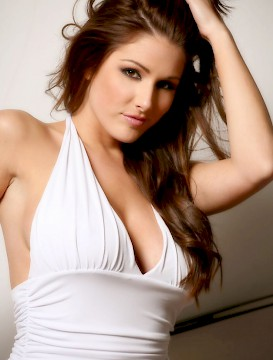 brunette Lucy Pinder in white stockings and panties takes off her dress