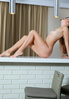 sexy babe Stefany Sonri shows off her stunning body on the counter