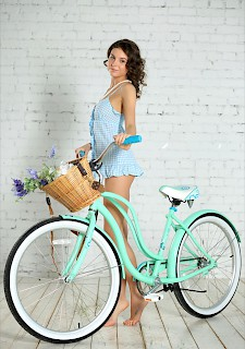 Hot brunette teen 18+ with a bike