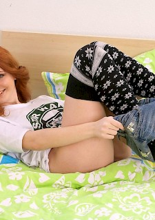 Redhead teen Petra strips and shows her sexy body