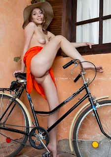 sweet girl Nikia A gets naked with her bicycle