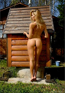 cute girl Sweet Lilya gets naked in the backyard