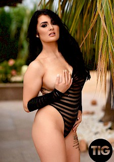 hottie girl Ashleigh Gee strips out of her black striped bodysuit