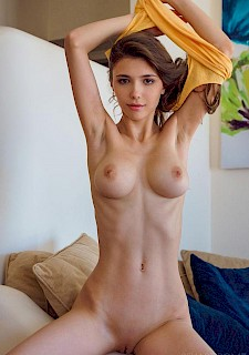 hot girl Mila Azul gets naked and spreads her legs