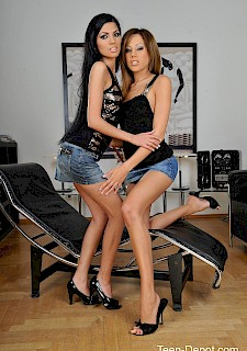 Two sexy lesbians girls fuck each other with a strap-on