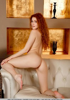 sexy redhead babe Adel C gets naked for you on the couch