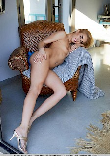 Blonde hot girl Cherry Kiss strips down to her high-heels