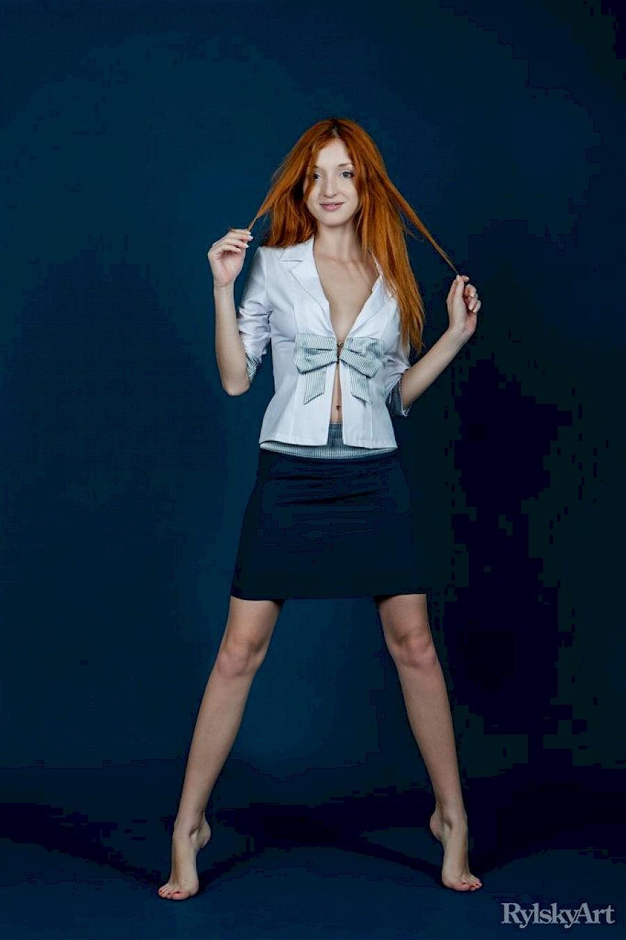 Redhead stripping nude