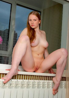 sexy and cute redhead girl with big natural tits gets naked for you