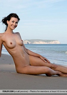 pretty model babe Lauren goes nude on a beach
