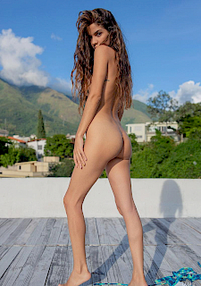 latina Katrina Osuna strips out of bikini