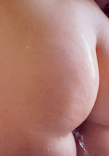 Stiffening nipples and shaved pussy