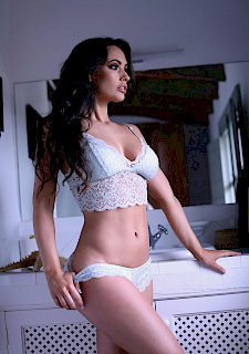 brunette Annie strips in white lingerie
