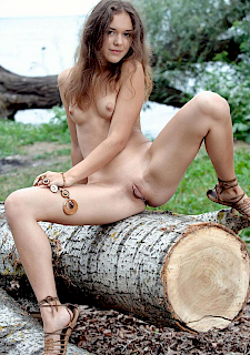 pretty girl Jenya A poses nude outside in debut